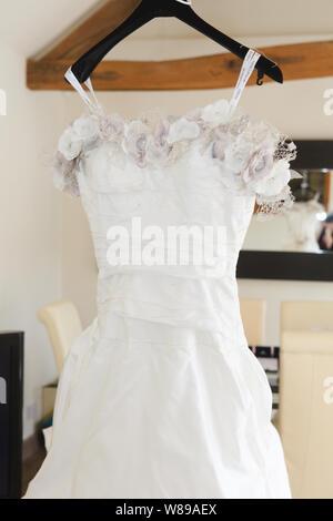 Ian Stuart Floral Wedding Dress - Stock Photo