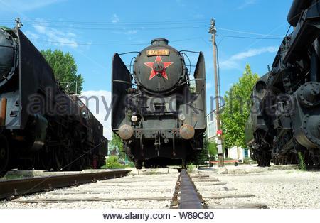A trio of old steam locomotives at the Hungarian Railway Museum (Magyar Vasuttorteneti Park). Budapest, Hungary. - Stock Photo