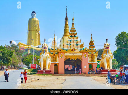 MONYWA, MYANMAR - FEBRUARY 22, 2018: The entrance gate of Aung Sakkya Pagoda of Maha Bodhi Ta Htaung monastery with chinthe (lion) statues, Aung Sakky - Stock Photo