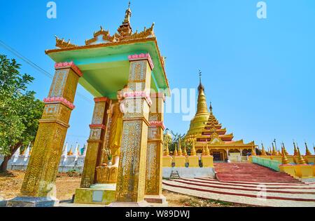 Explore scenic Aung Sakkya Pagoda with many small shrines and giant gilt stupa, Maha Bodhi Ta Htaung monastery, Monywa, Myanmar - Stock Photo