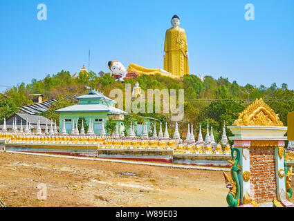 Reclining and Standing Buddha Images are famous landmarks of Maha Bodhi Ta Htaung Monastery, Monywa, Myanmar - Stock Photo