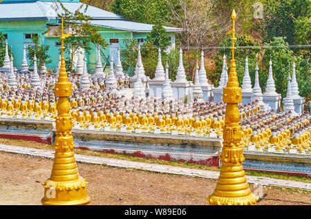 Thousand of carved Buddha Images and small stupas in site of Aung Sakkya Pagoda of Maha Bodhi Ta Htaung Monastery, Monywa, Myanmar - Stock Photo