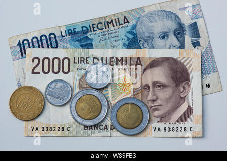 Pre-Euro Italian Lira currency, banknotes and coins - Stock Photo
