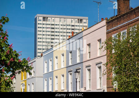 Poynter House high rise tower block behind expensive Notting Hill house houses, Kensington and Chelsea, London, UK - Stock Photo