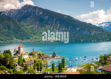 Spiez castle on lake Thun in Spiez in the Bernese Oberland of Switzerland - Stock Photo