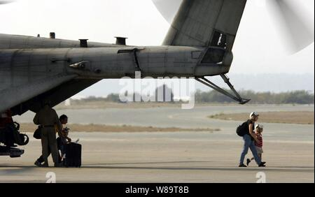 U.S. citizens exit a U.S. Marine Corps CH-53 Super Stallion helicopter at Royal Air Force Base Akrotiri in Cyprus following their flight from the U.S. Embassy in Beirut, Lebanon, on July 17, 2006.  At the request of the U.S. Ambassador to Lebanon and at the direction of the Secretary of Defense, the United States Central Command and 24th Marine Expeditionary Unit are assisting with the departure of U.S. citizens from Lebanon.  The helicopters are attached to Marine Medium Helicopter Squadron 365.
