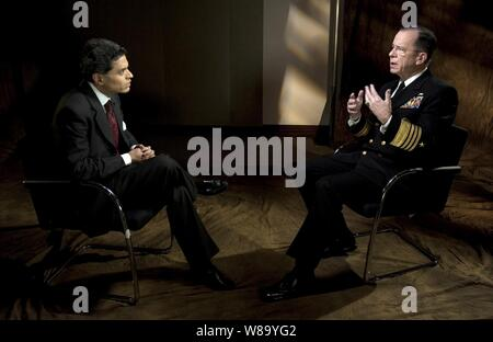 Chairman of the Joint Chiefs of Staff Adm. Mike Mullen, U.S. Navy, is interviewed by CNN's Fareed Zakaria in New York City on Nov. 24, 2010. - Stock Photo