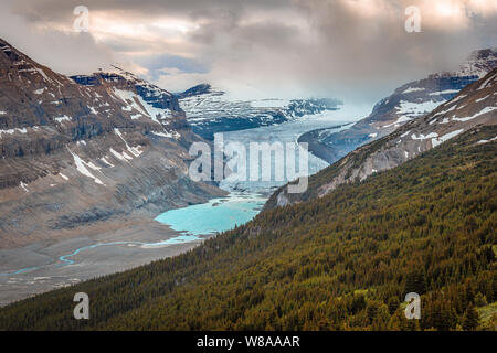 The ice at Parker Ridge Glacier slowly melts into the lake below. - Stock Photo