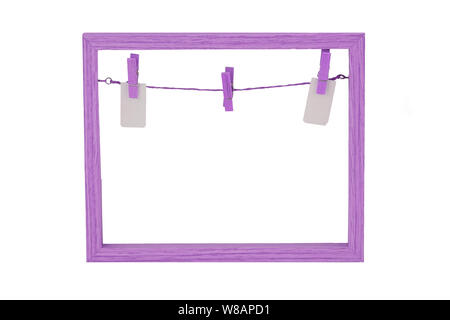 Empty wooden frame. Close-up of Empty violet wooden frame with a clothesline and clothespins on background of frame Isolated on white. Food recipe, va - Stock Photo