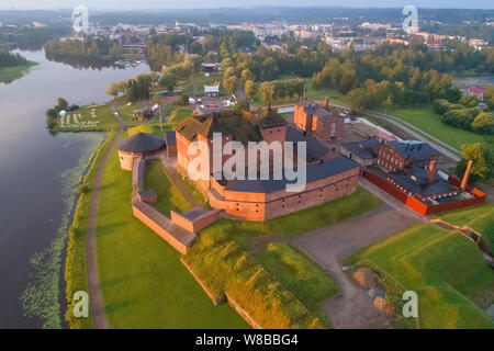Ancient fortress in a cityscape in the early July morning (aerial photography). Hameenlinna, Finland - Stock Photo