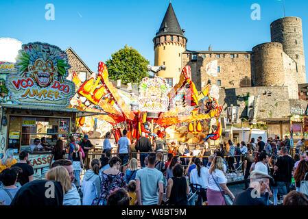 Mayen Germany 14.10.2018 people fairground huge carousel swing ride at biggest folk festival in Rhineland Palantino the lukasmarkt in Mayen. - Stock Photo
