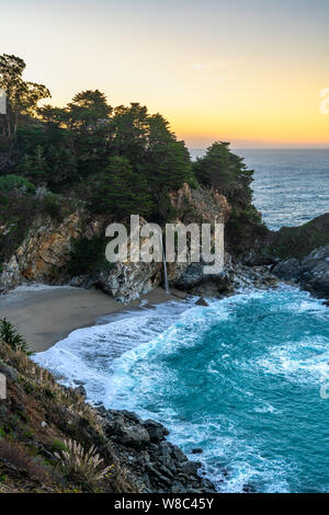 Stunning McWay Falls pouring on to the beach along the Big Sur, California coastline on the west coast of the United States of America.
