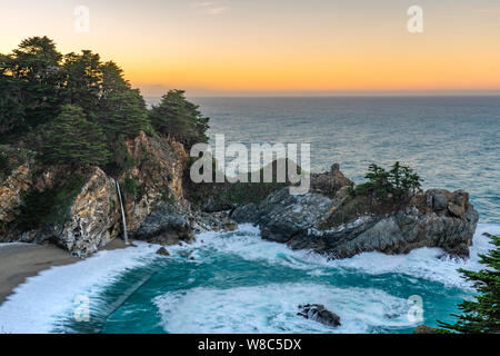 View of the beautiful McWay Falls from the lookout along the Pacific coastline in California. - Stock Photo
