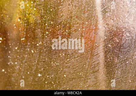Rain Drops On Surface of wet Window Glass pane In Rainy Season. Abstract background. Natural Pattern of raindrops isolated from outdoor cloudy environ - Stock Photo