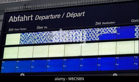 Frankfurt, Germany - July 13, 2019: Malfunctioning schedule display of the German train service at Frankfurt train station. - Stock Photo