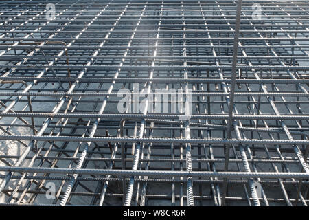 Steel grid of residential building footing reinforcement. - Stock Photo