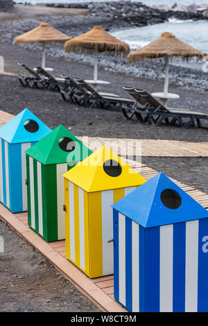 Coloured recycling waste bins on the beach for collecting and seperating refuse, Playa San Juan, Tenerife, Canary Islands, Spain - Stock Photo