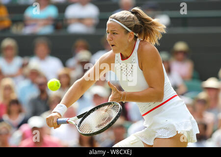 Czech tennis player Karolina Muchova playing backhand volley during 2019 Wimbledon Championships, London, England, United Kingdom - Stock Photo