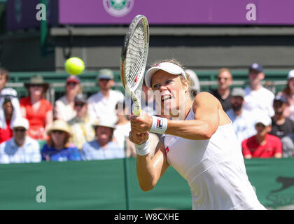 German tennis player Laura Siegemund playing backhand shot during 2019 Wimbledon Championships, London, England, United Kingdom - Stock Photo