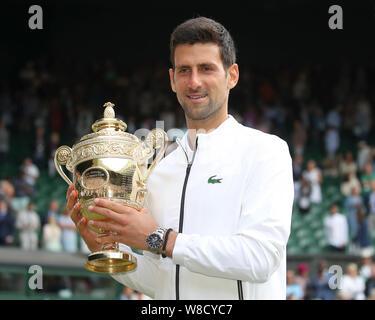 Serbian tennis player Novak Djokovic posing with trophy during trophy presentation in 2019 Wimbledon Championships, London, England, United Kingdom - Stock Photo