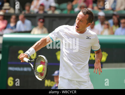 German tennis player Philipp Kohlschreiber playing backhand shot during 2019 Wimbledon Championships, London, England, United Kingdom - Stock Photo