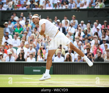 Spanish tennis player Rafael Nadal playing service shot during 2019 Wimbledon Championships, London, England, United Kingdom - Stock Photo