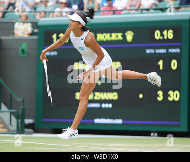 Chinese tennis player Shuai Zhang playing service shot during 2019 Wimbledon Championships, London, England, United Kingdom - Stock Photo