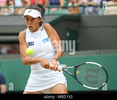 Chinese tennis player Shuai Zhang playing backhand  shot during 2019 Wimbledon Championships, London, England, United Kingdom - Stock Photo