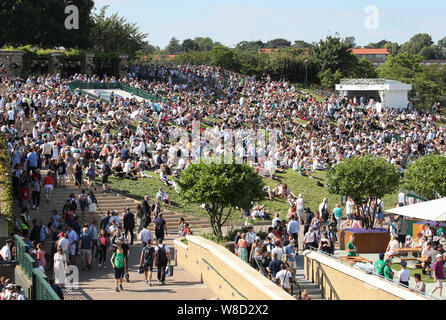 Elevated view of spectators on Henman Hill during 2019 Wimbledon Championships, London, England, United Kingdom - Stock Photo