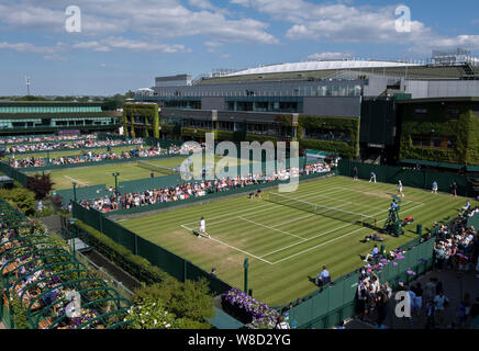 Elevated view of spectators watching play on outside courts with Centre Court in the background during 2019 Wimbledon Championships, London, England, - Stock Photo