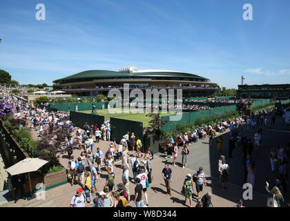 Elevated view of spectators walking around outside courts with  Court 1 in the background during 2019 Wimbledon Championships, London, England, United - Stock Photo