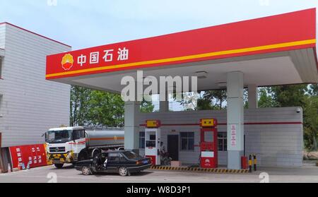 --FILE--Vehicles are being refueled at a gas station of PetroChina, a subsidiary of CNPC (China National Petroleum Corporation), in Chongqing, China, - Stock Photo