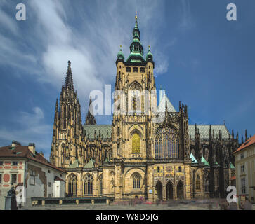 The Metropolitan Cathedral of Saints Vitus or St. Vitus Cathedral located within Prague Castle during sunny day with no people. - Stock Photo