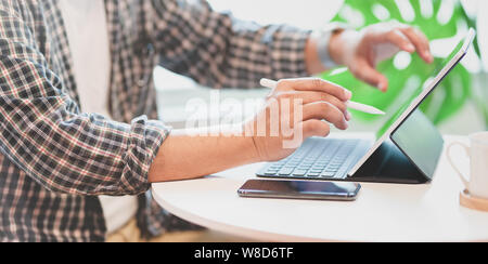 Young professional businessman preparing his strategy plan for the next meeting - Stock Photo