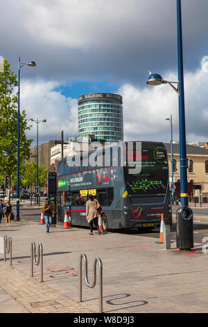 The busy Moor Street Queensway in the Centre of Birmingham, a bus on the Platinum service waits to pick up Passengers, The Bull Ring in the Background, UK - Stock Photo