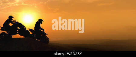 Silhouette ATV or Quad bikes Jump in sunset. Stock Photo