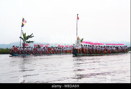 Traditional boats on the 'Karaweik' festival celebration on the Inle Lake in Myanmar/Burma. - Stock Photo