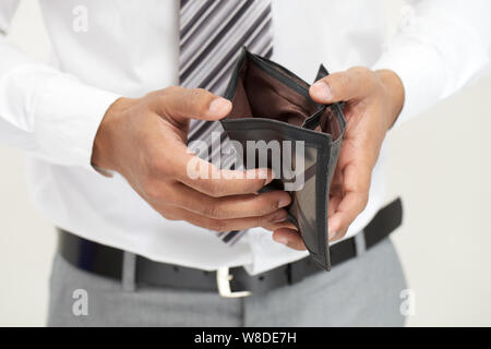 Midsection of a businessman showing empty wallet - Stock Photo