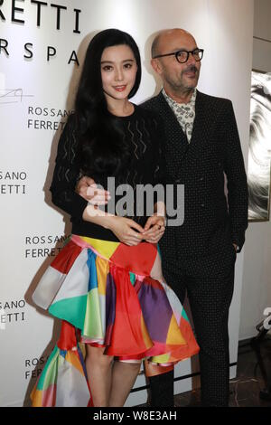 Chinese actress Fan Bingbing (left) poses with executive of Rossano Ferretti during the opening ceremony for a new store of Rossano Ferretti Hair Spa - Stock Photo