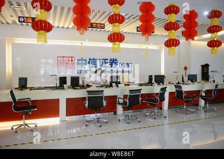 --FILE--A Chinese employee works at a branch of Citic Securities in Qingdao city, east China's Shandong province, 21 August 2015.     Chinese authorit - Stock Photo