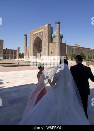 Bridal Couple at Registan Square, Samarkand, Uzbekistan, Asia - Stock Photo