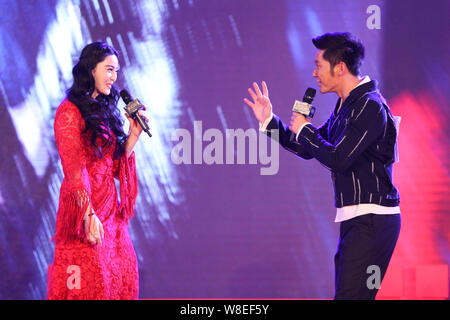--FILE--Chinese actress Fan Bingbing, left, interacts with actor Li Chen during a press conference for the screening of their new TV drama 'The Empres - Stock Photo