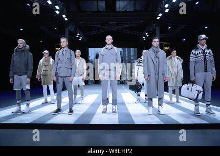 Models display new creations at the Hogan 2015 Fall/Winter fashion show during the Milan Fashion Week in Milan, Italy, 17 January 2015. - Stock Photo