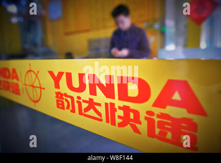 --FILE--A Chinese employee works at a branch of Yunda Express in Foshan city, south Chinas Guangdong province, 12 November 2014.   The total revenue o - Stock Photo