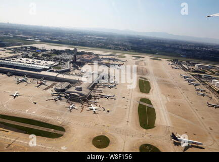 --FILE--Aerial view of passenger jets on an parking apron at the Beijing Capital International Airport in Beijing, China, 10 September 2013.   Beijing - Stock Photo