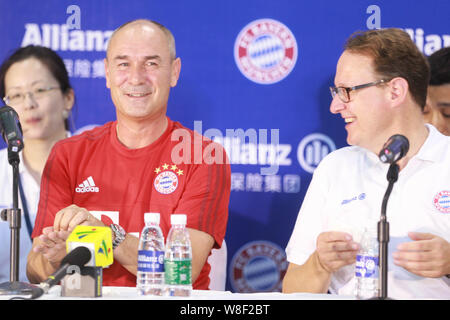 Former German soccer star Raimond Aumann, left, smiles during a fan meeting event in Guangzhou city, south China's Guangdong province, 23 July 2015. - Stock Photo