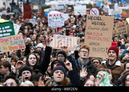 Warszawa, 15.03.2019. Students hold placards as they take part in a 'youth strike to act on climate change' demonstration in Warsaw, Poland. photo. Andrzej Hulimka/ Forum  # POLAND OUT # - Stock Photo