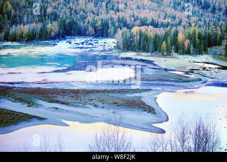 Landscape of Kanas Lake in the snow in Altay Prefecture, southwest China's Xinjiang Autonomous Region, 7 December 2015. - Stock Photo