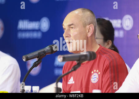 Former German soccer star Raimond Aumann speaks during a fan meeting event in Guangzhou city, south China's Guangdong province, 23 July 2015. - Stock Photo
