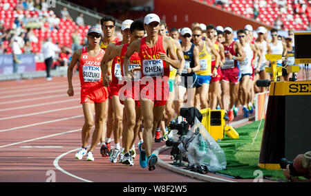 Athletes compete in the men's 20km Walk during the Beijing 2015 IAAF World Championships in Beijing, China, 23 August 2015. - Stock Photo